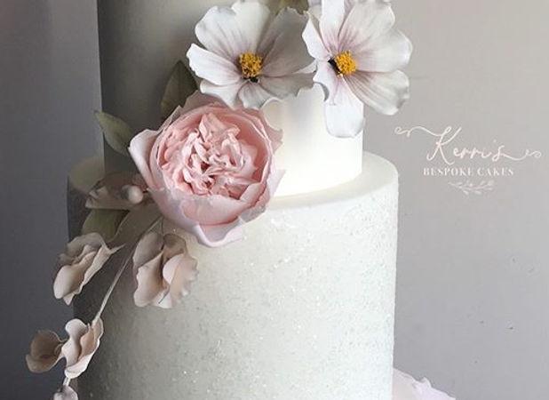 Blush pink ruffle sparkle wedding cake
