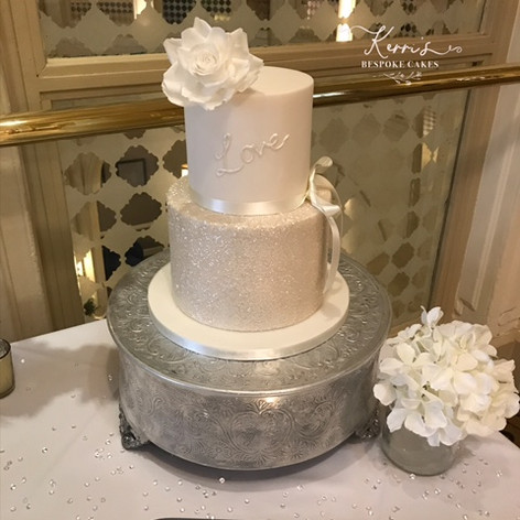 All white wedding cake with rose at Midl