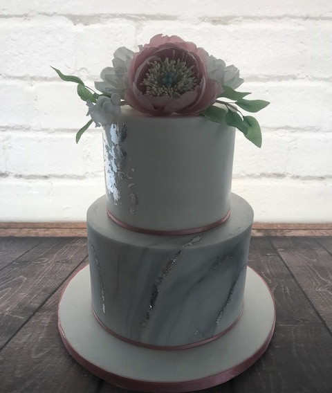 Pink and silver marbled wedding cake