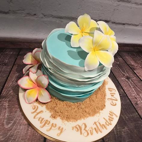Hawaiian themed cake with handmade plume