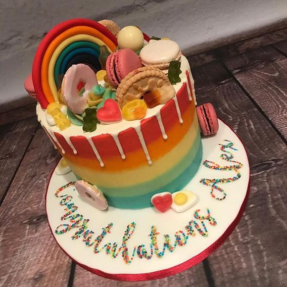 Bright rainbow sweet drip cake