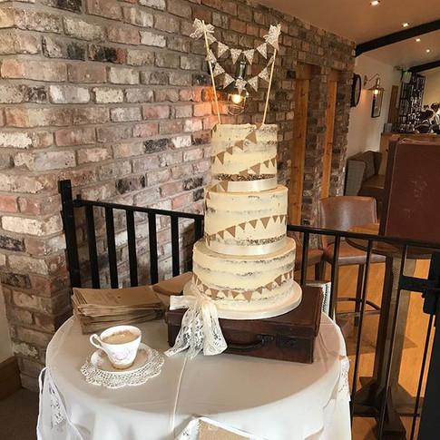 Semi-naked buttercream wedding cake