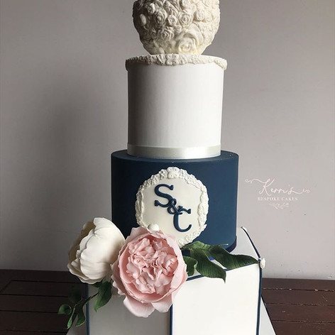 White and Navy bas relief wedding cake
