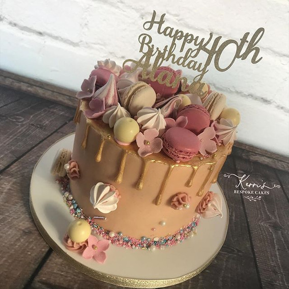 Pink and gold drip cake