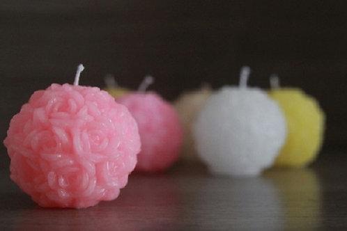 Vela bola com flor