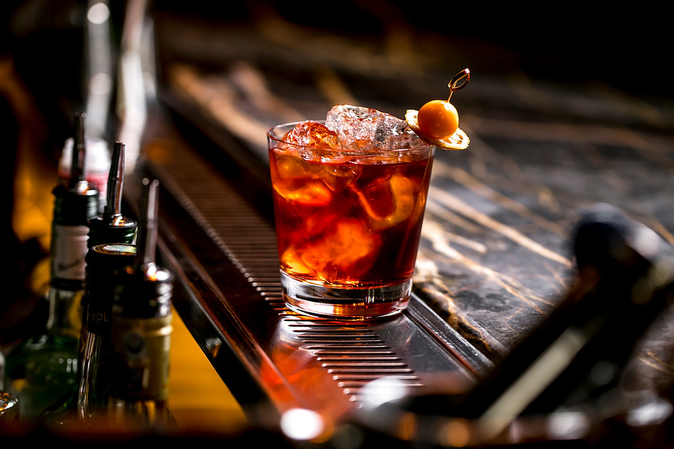 cocktail-glass-with-ice-cubes-garnished-