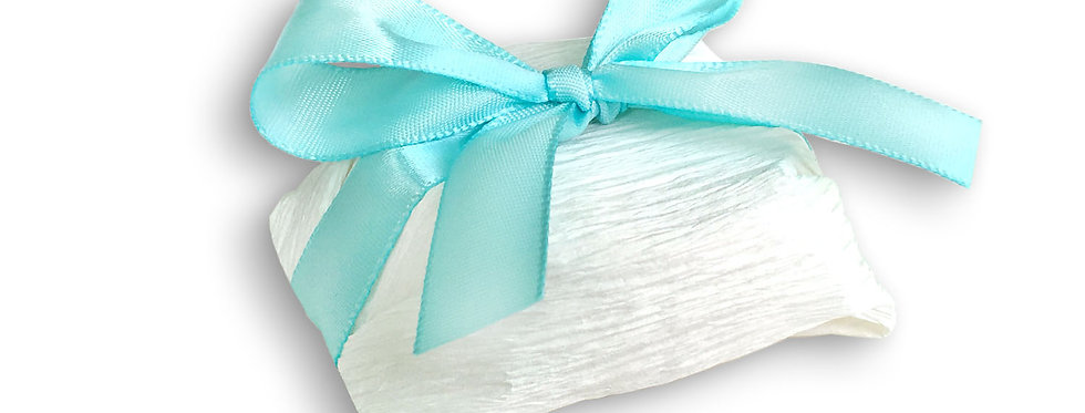 White Wrapping with Teal Ribbon