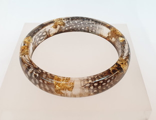Resin bangle with feather inclusions...j