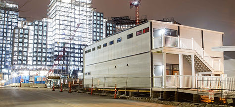 Photo of modular construction office located on the site of Amazons new campus under constuction in Boston