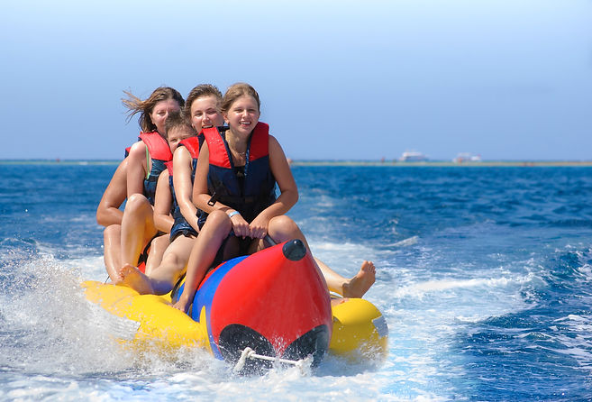 People ride on banana boat. Bright blue sea and clear sky. Happy vacation_edited.jpg