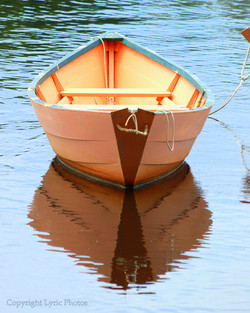 wooden hand made dory boat photo