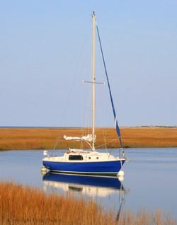 sail boat marsh cape cod photo