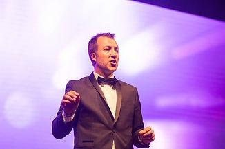 mike crump presenter presenting awards.