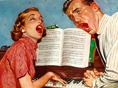 A couple singing a song at the piano.