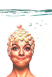 Woman holding her breath underwater.