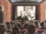 cinema audience watching a film movie.