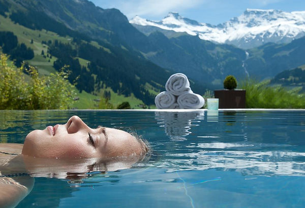 girl in swimming pool in nature