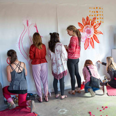 We cover the walls in giant sheets of paper and provide a plethora of paints for making communal art—and new friends.