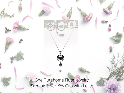 She. Flutehome sterling necklace with lolite pendant