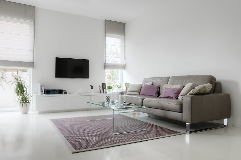 White living room with taupe leather sof
