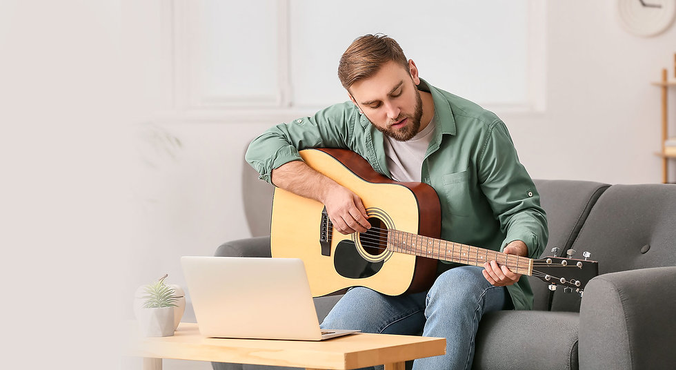 young-man-taking-music-lessons-online-at