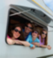 Family looking out a caravan window