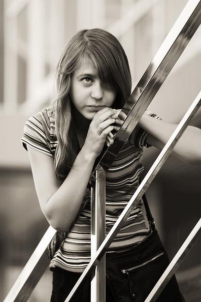 Sad teen girl against a school building .jpg
