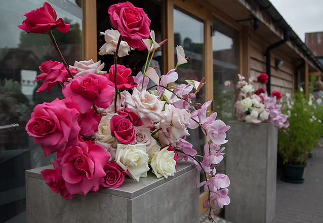 Modern pink wedding flowers with roses and orchids