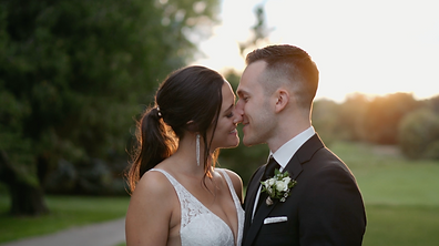 sunset wedding couple kiss