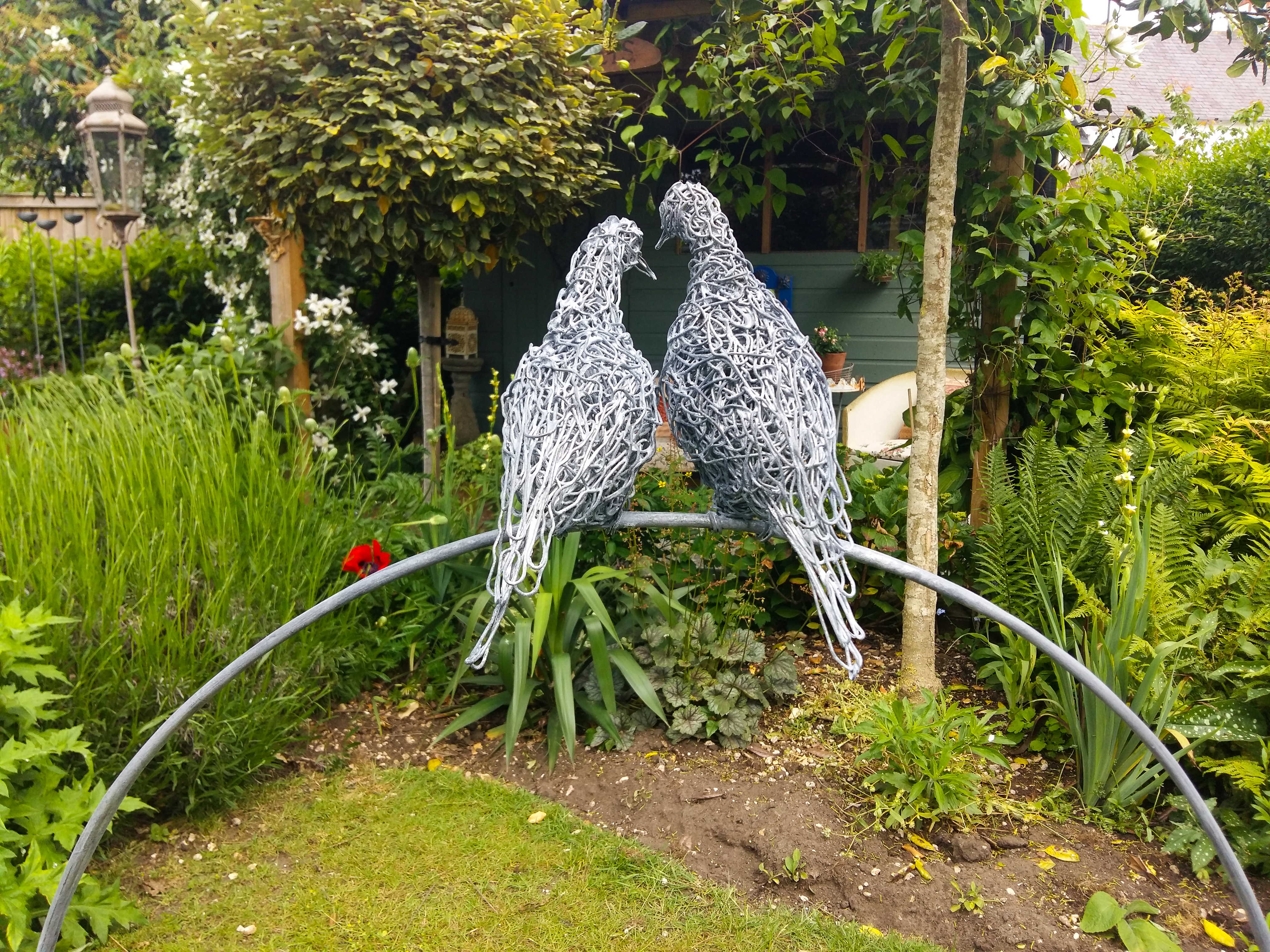 Wire dove sculptures, galvanised and etched