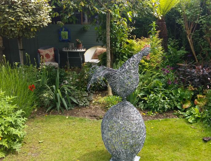 Cockerel and egg sculpture