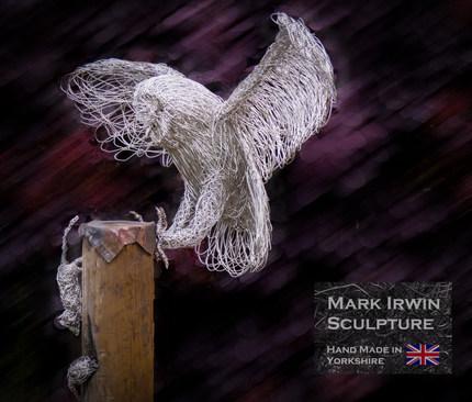 Owl landing on post