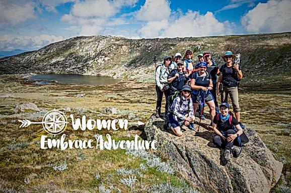 Women Embrace Alpine Hiking Snowy Mountains