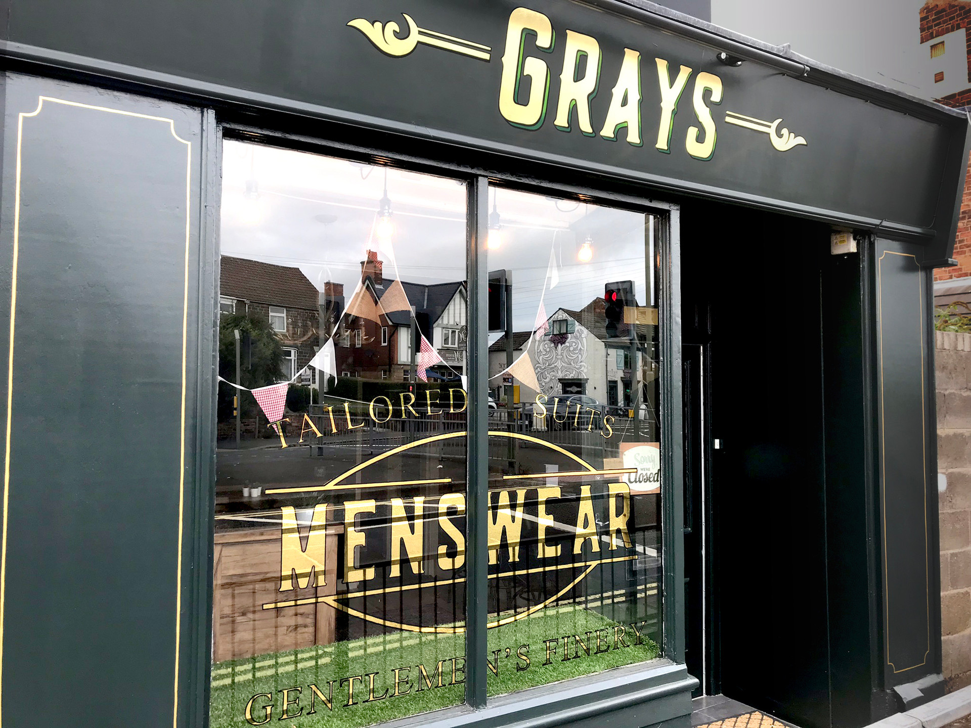 gold leaf painted sign and window.jpg