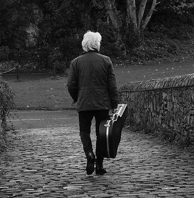 Mick with guitar on bridge.jpeg