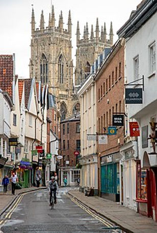 220px-Lower_Petergate_in_York,_England.j