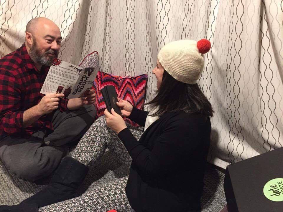 Subscribers Victoria and Jay enjoying the June Escape Room Crate.