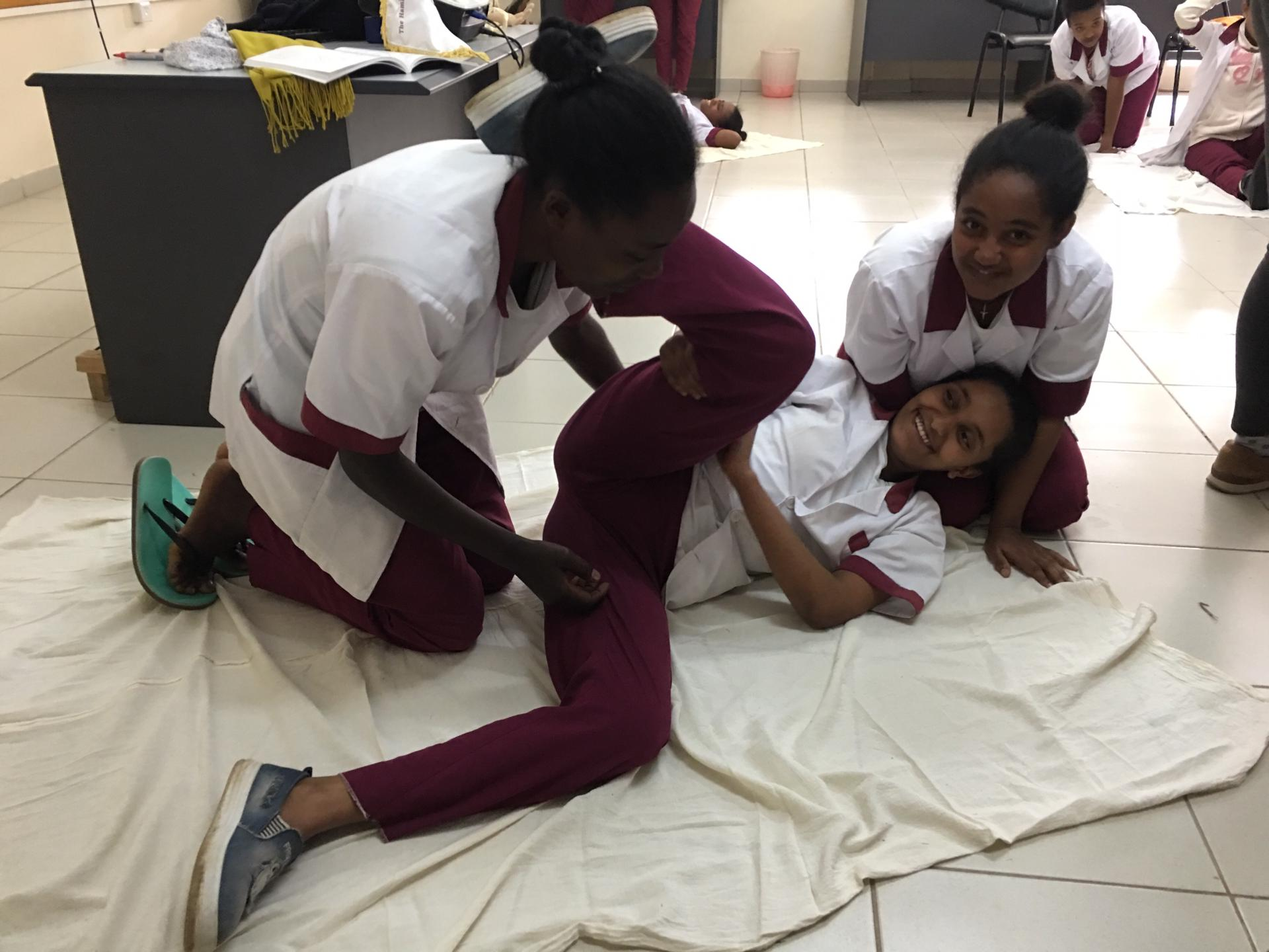 Students simulating a birth