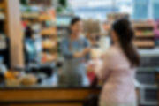 Woman at the cashier in a grocery store