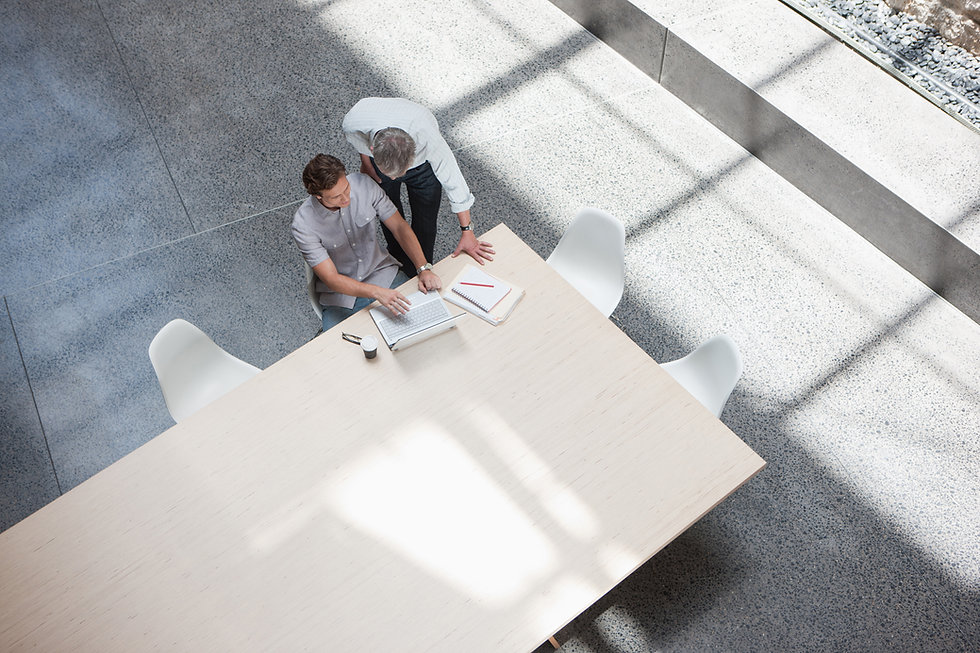 Two men working in a modern minimalistic office space