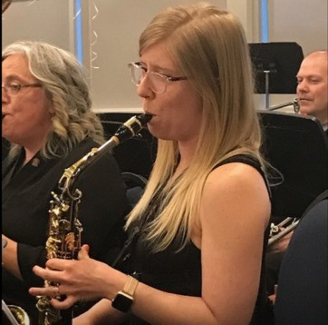 Dr. Starko playing her Alto Saxophone