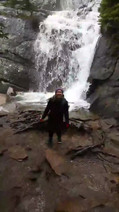 Dr. Starko in front of the waterfall by the Lake Agnes Tea House