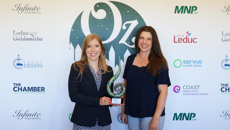 Dr. Starko and Taylor with Leduc Chamber of Commerce 2019 Young Business Leader of the Year Award