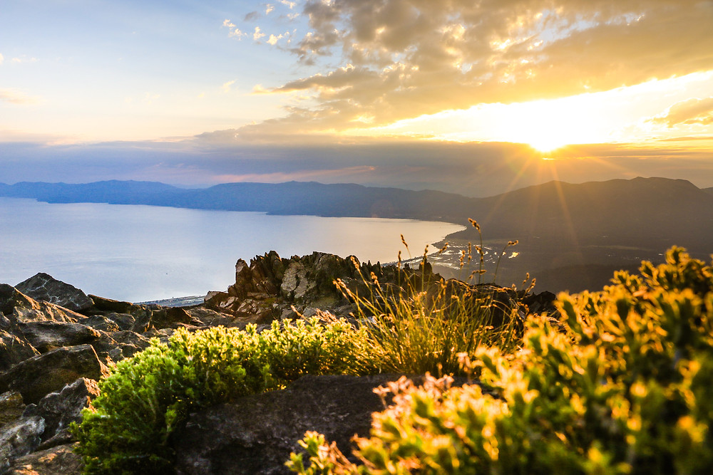 Sun rising over lake tahoe from view of mount tallac
