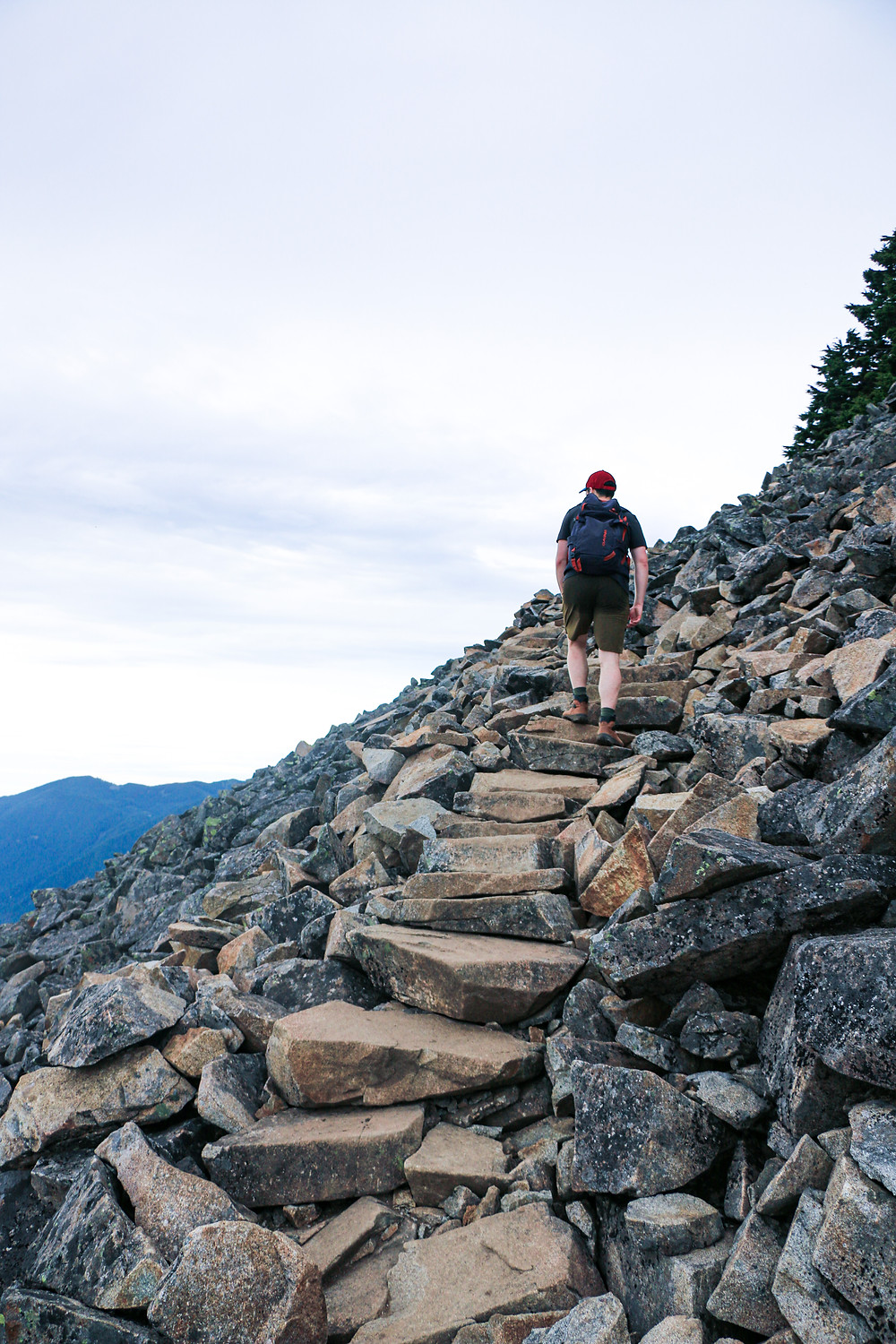 Man walking on rock steps on mailbox peak trail