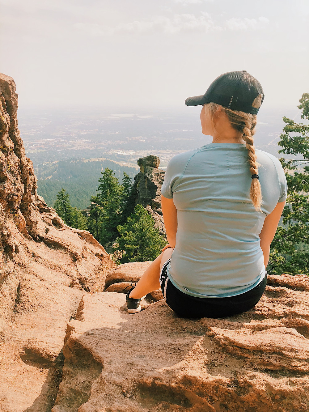 Girl overlooking a view from the flatirons