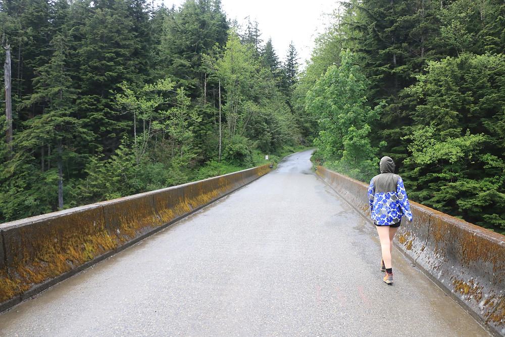Woman Walking on a bridge to Dirty Harry's Balcony Trail