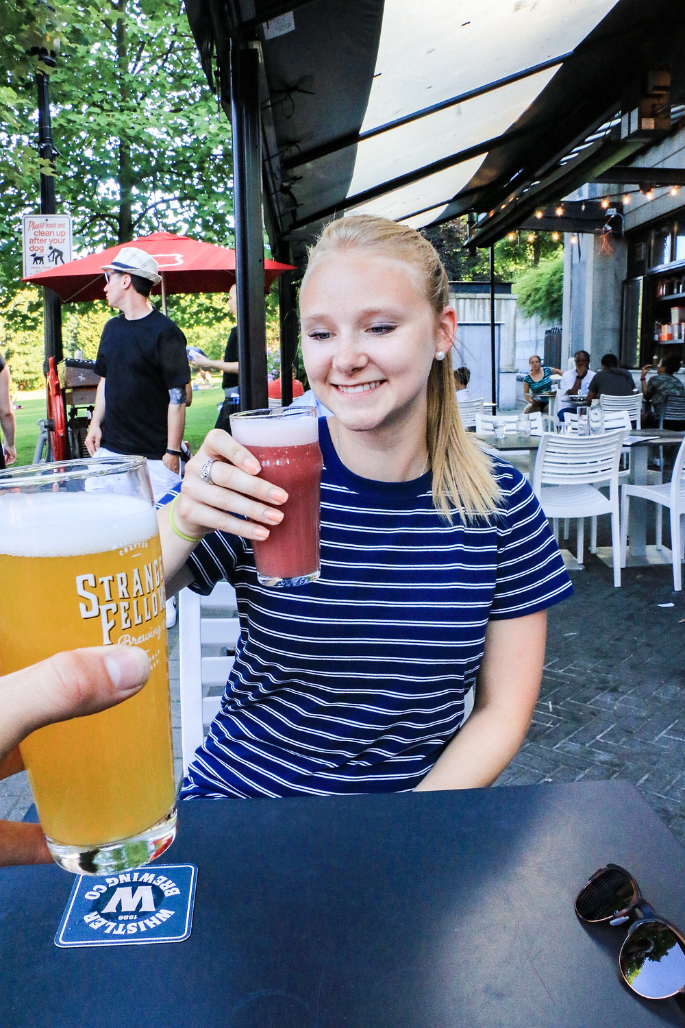 Girl drinking beer at TAPshack in Vancouver
