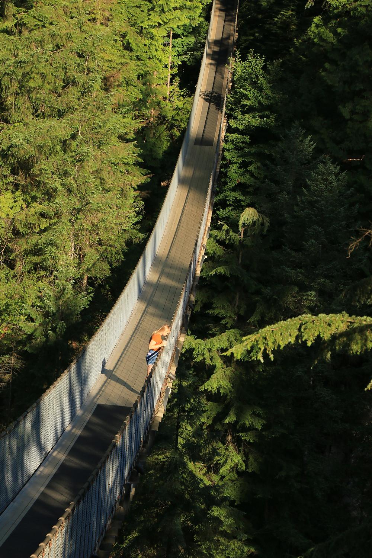 Girl standing alone on Capilano Suspension Bridge