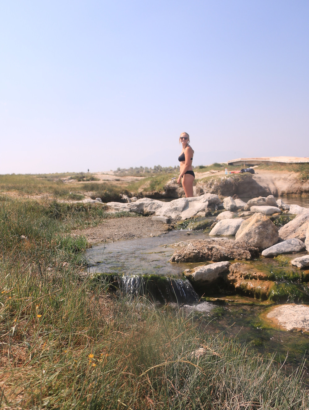 A girl standing in hot springs